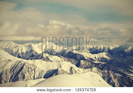 View from ski slopes. Caucasus Mountains Georgia region Gudauri. Toned landscape.