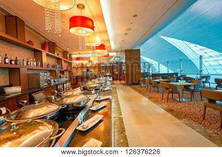 DUBAI, UAE - MARCH 09, 2016: interior of Emirates business class lounge. Emirates is the largest airline in the Middle East. It is an airline based in Dubai, United Arab Emirates.