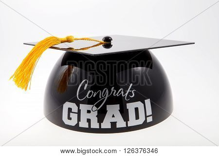 A graduation cake topper against a white background
