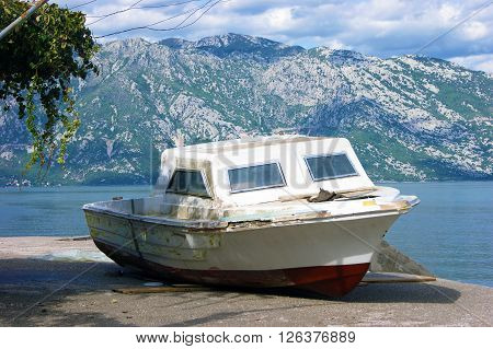 A small pleasure boat on the seashore