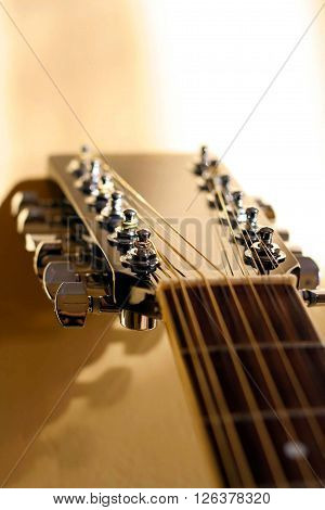 A detail on a twelve-string guitar neck