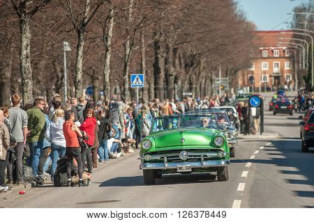NORRKOPING, SWEDEN - MAY 1: Ford Crestline Sunliner 1954 at classic car parade celebrating spring on May 1, 2013 in Norrkoping. This parade started in 1974 and has become an annual tradition in Norrkoping on May 1.