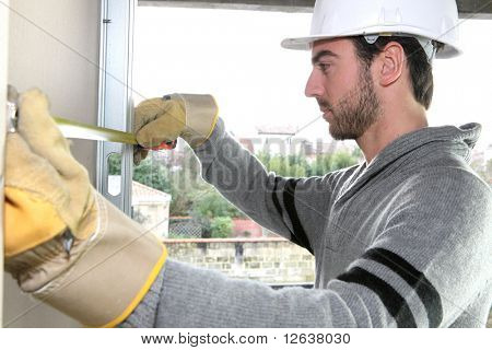 Worker with plasterboard