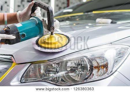 Car detailing series : Closeup of hand polishing grey car