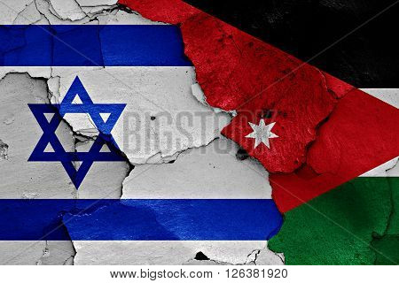 flags of Israel and Jordan painted on cracked wall