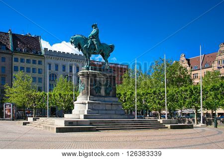 Malmo Sweden - June 27 2010: The big square and the statue of king Charles X Gustav. Malmo is Sweden's third largest city dates back to the 16th century.