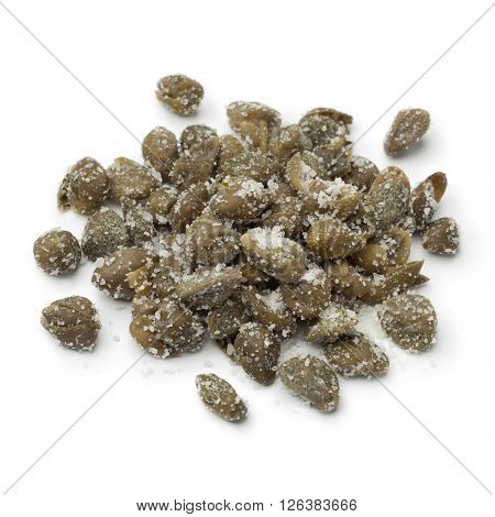 Heap of salted capers on white background