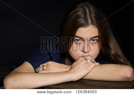 Portrait of a girl with diamonds on black dackground. ** Note: Shallow depth of field