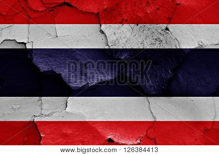 flag of Thailand painted on cracked wall