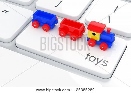 Wooden Colorful Train Toy On The Computer Keyboard. Play Games Concept