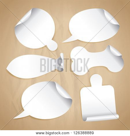 Empty white stickers on a paper - speech bubbles, board for pizza, cutting board, bone for pet, fish silhouette.
