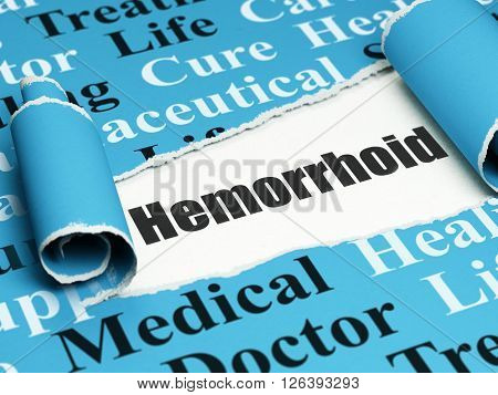 Health concept: black text Hemorrhoid under the piece of  torn paper