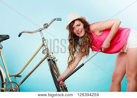Woman Pumping Up Tire Tyre With Bike Pump.