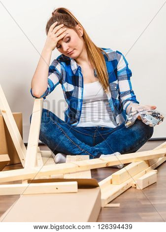 Stressed Woman Assembling Wooden Furniture. Diy.