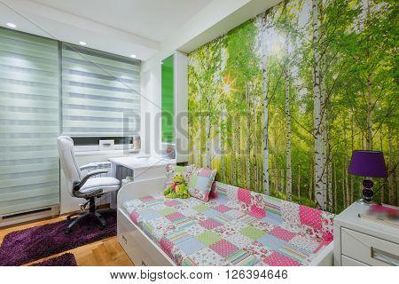 Children's room interior with wallpaper mural photo