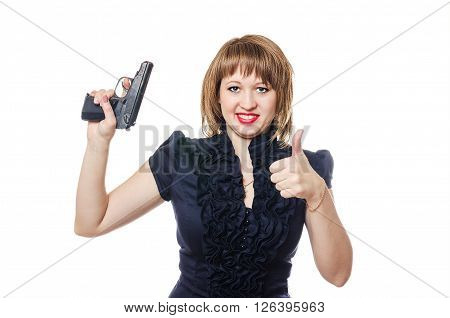 The young woman from the pistol in a hand shows a class and smiles