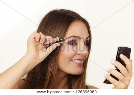Woman Tweezing Eyebrows Plucking With Tweezers
