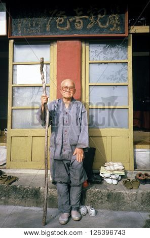 SONGNISAN NATIONAL PARK / KOREA - CIRCA 1987: A Buddhist monk poses for a photograph outside of his hermitage on a mountain in Songnisan National Park.