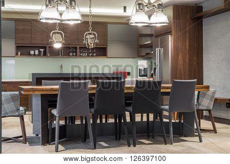 Kitchen And Dining Area In Luxury Villa Interior