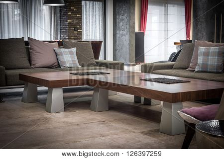 Cofe table and sofa modern living room interior with wooden cofe table and pastel sofa