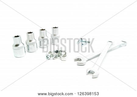 Wrenches, Heads And Screws On White
