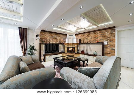 Luxury living room interior with fireplace and big brick wall