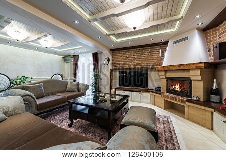 Fireplace and modern sofa in luxury living room interior