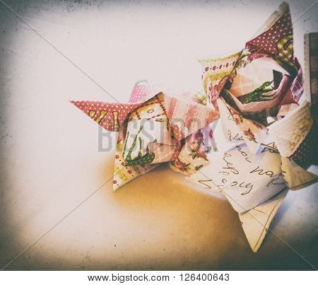 Paper origami tulips in vintage processing vignetting