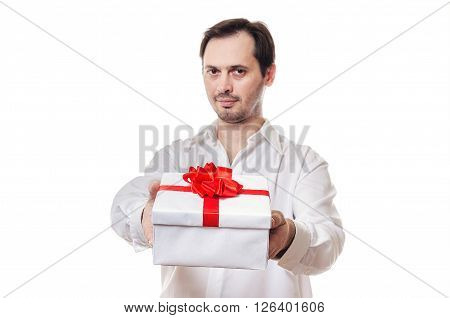 The man holds the beautiful box with a gift which is tied up by a bow in hand