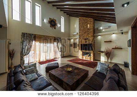 Intrior design of modern loft apartmentnt with fireplace