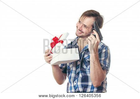 The man with the pistol rejoices to a gift in a white box with a red bow.