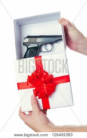 White a box about a red bow a gift about the pistol in hands