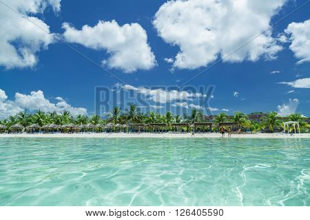 Amazing inviting view of Cuban, Cayo Coco island beach from the tranquil turquoise ocean side
