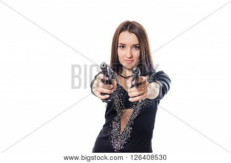 The dangerous young woman with long hair shoots from the pistols