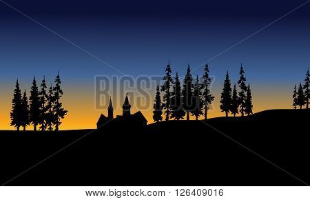 House and spruce trees in afeternoon scenery