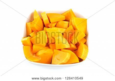 chopped butternut squash in the bowl on white background