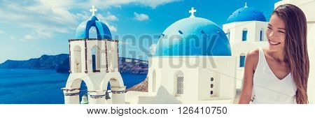 Europe tourist travel woman panorama banner from Oia, Santorini, Greece. Happy young woman looking at famous blue dome church landmark destination. Beautiful girl visiting the Greek islands.