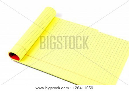 close up on yellow writing pads on white background