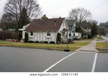 HARBOR SPRINGS, MICHIGAN / UNITED STATES - DECEMBER 23, 2015: A small home at the corner of Traverse and Second Streets in Harbor Springs.