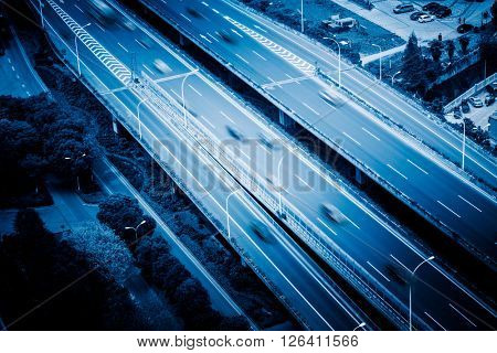 aerial view of highway traffic,blue toned image.