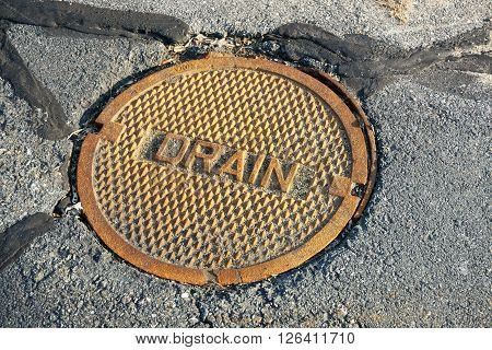 close up on rustic manhole cover for drain system