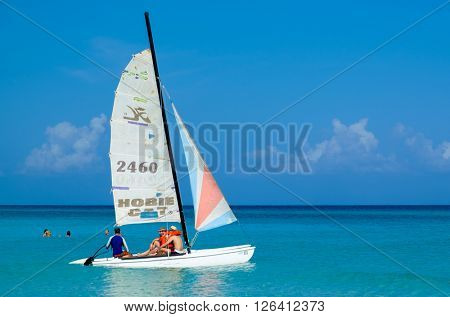 HAVANA,CUBA- MARCH 17,2016 : Tourists sailing at the beautiful beach of Varadero in Cuba