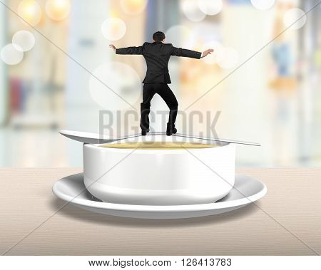 Rear View Man Balancing On Spoon With Soup Bowl