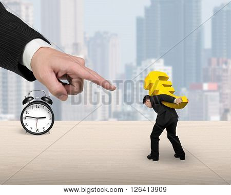 Man Carrying Golden Euro Sign With Big Forefinger Pointing At