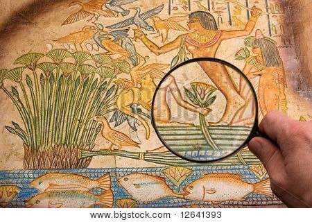 Magnifying Glass On Antique Papyrus