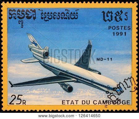 MOSCOW RUSSIA - APRIL 19 2016: A stamp printed in Cambodia shows passenger aircraft McDonnell Douglas MD-11 series