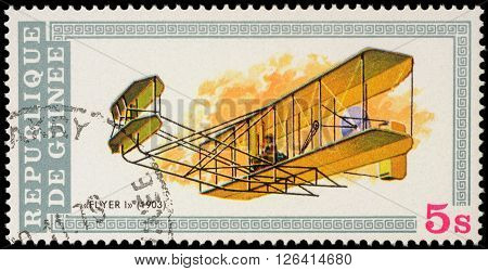 MOSCOW RUSSIA - APRIL 17 2016: A stamp printed in Guinea shows flight of the first airplane of Wright brothers (1903) series