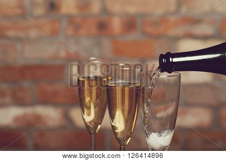 Alcoholic drink. Champagne pouring at the party