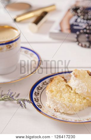 Coconut Buttermilk Pound Cake with Coffee on a white background