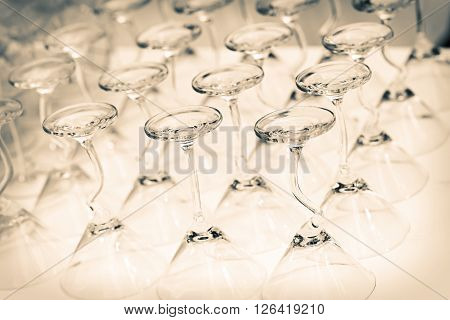 Group of empty cocktail glasses with hearth shape of watermelon on top preparing on table for party. Selective focus shallow depth of field.